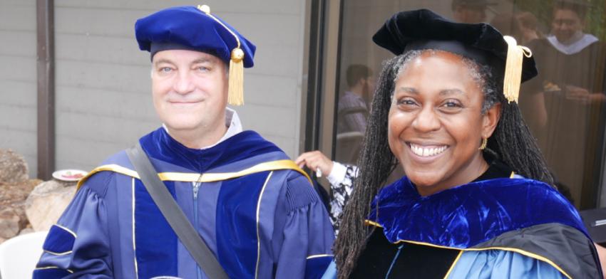 Professors Richard Wright and Alicia Wassink in regalia at graduation