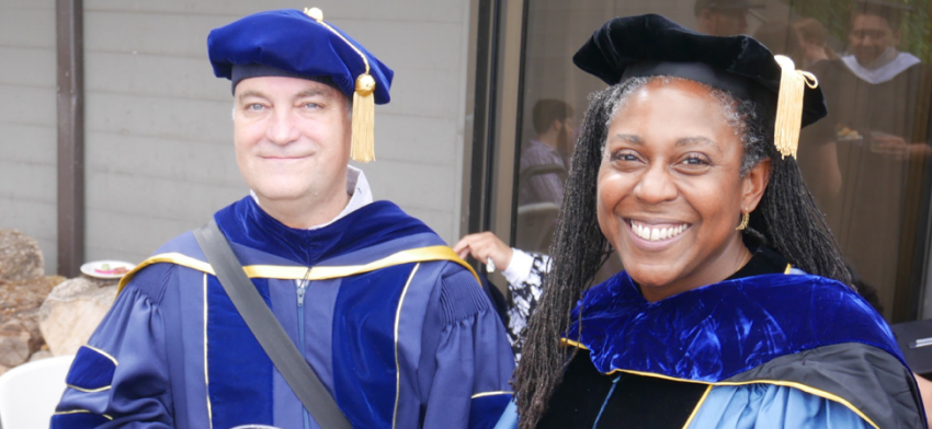 Professors Richard Wright and Alicia Wassink in regalia at graduation