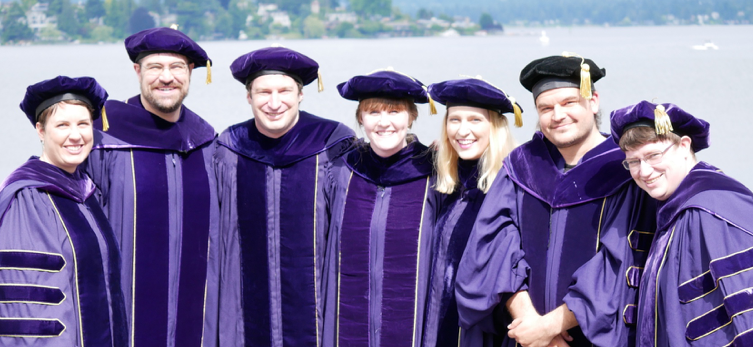 PhD graduates in doctoral regalia at graduation