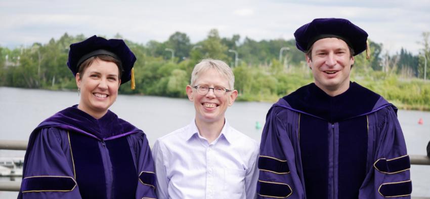 Professor Edith Aldridge with PhD graduates Amie DeJong and Alec Sugar at graduation