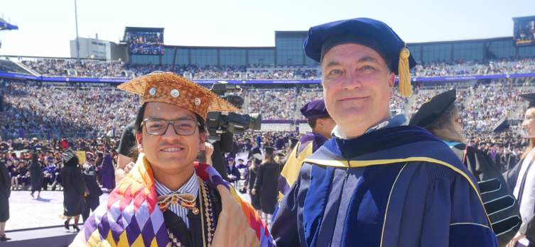 Bachelor of Arts graduate Peji Hota Wakhan at Commencement with Professor Richard Wright