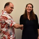 Laura Panfili and Richard Wright shake hands