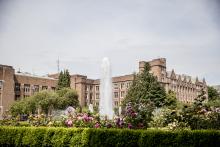 flowers bloom near Drumheller Fountain on campus