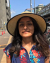 image of a girl wearing a sunhat on a street on a sunny day